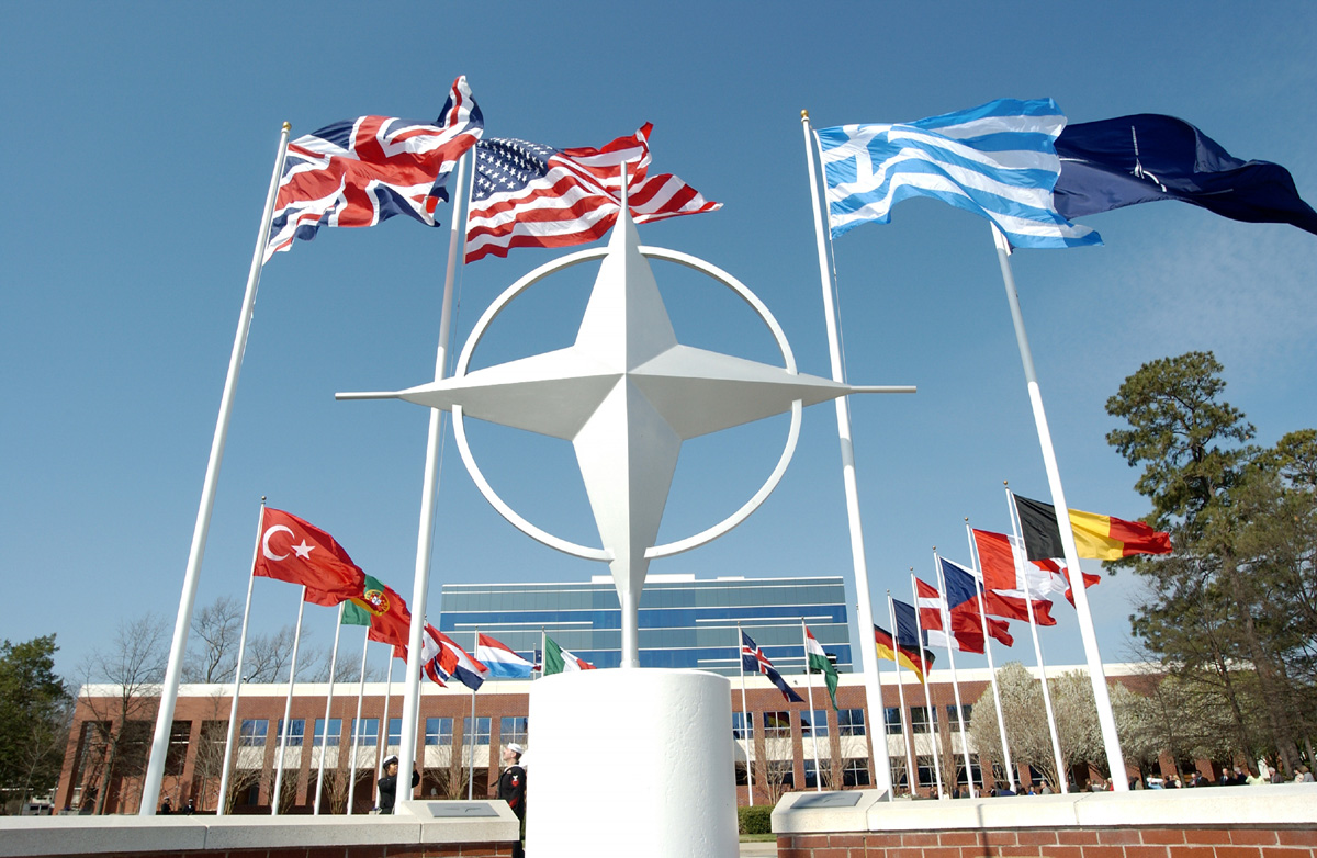 http://tvxs.gr/sites/default/files/article/2013/05/118435-nato-symbol-with-flags-of-member-countries.jpg